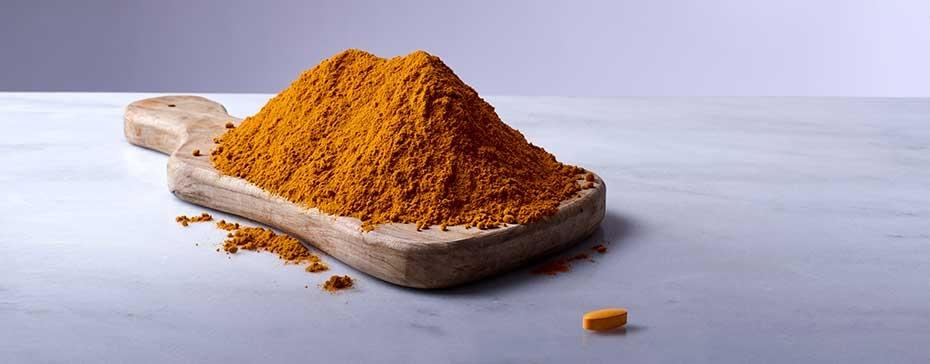 Turmeric powder and a turmeric tablet